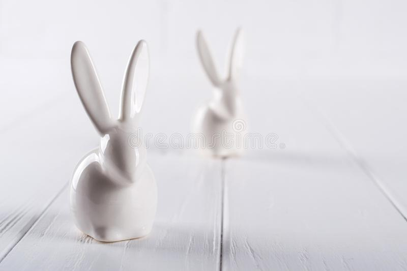 Two little easter bunny. One color minimal concept on white royalty free stock photography