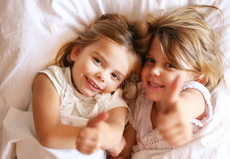 Two little girl in bed. royalty free stock photography