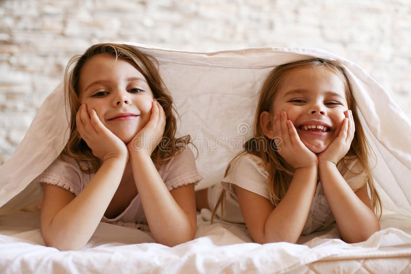 Two little girl in bed. stock images