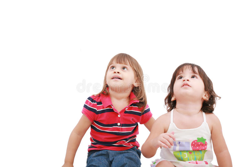 Two little girl looking up royalty free stock photography