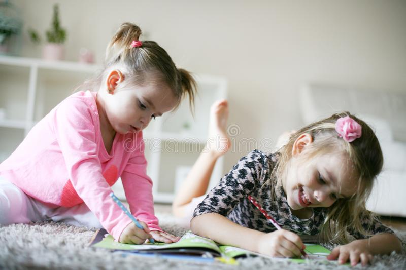 Happy childhood. Little girls at home. stock photos