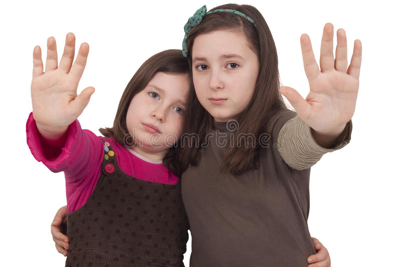 Two Little Girls Gesturing Stop Stock Photo