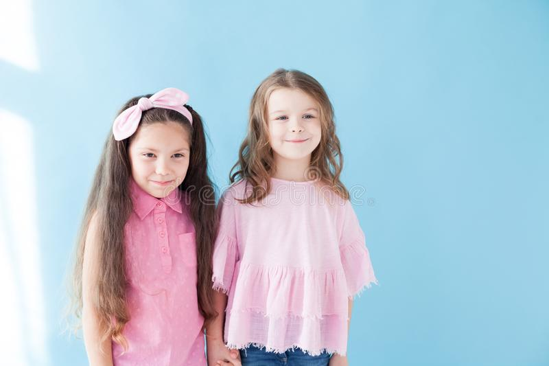 Two little girls girlfriend standing near nice stock images