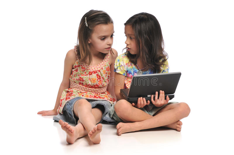 Two little girls with a laptop computer royalty free stock images