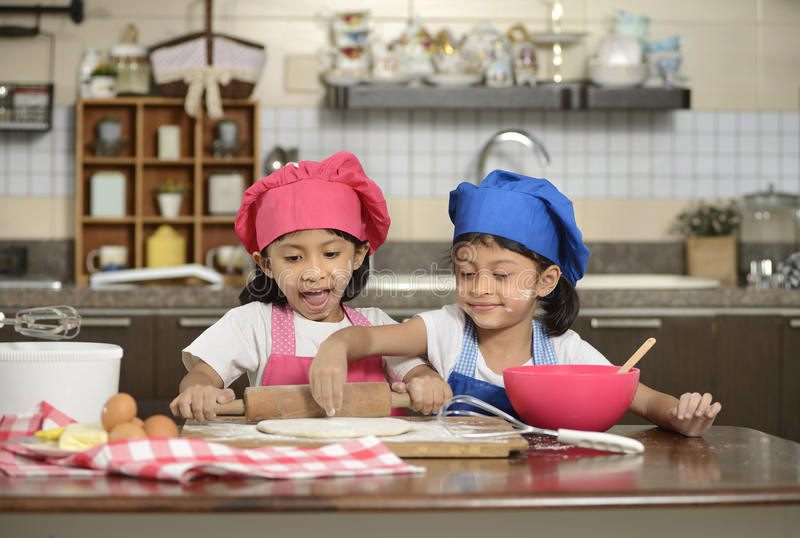 Two Little Girls Make Pizza royalty free stock photography