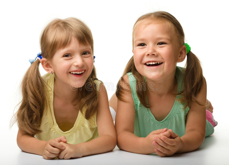 Two Little Girls Are Playing Stock Photos