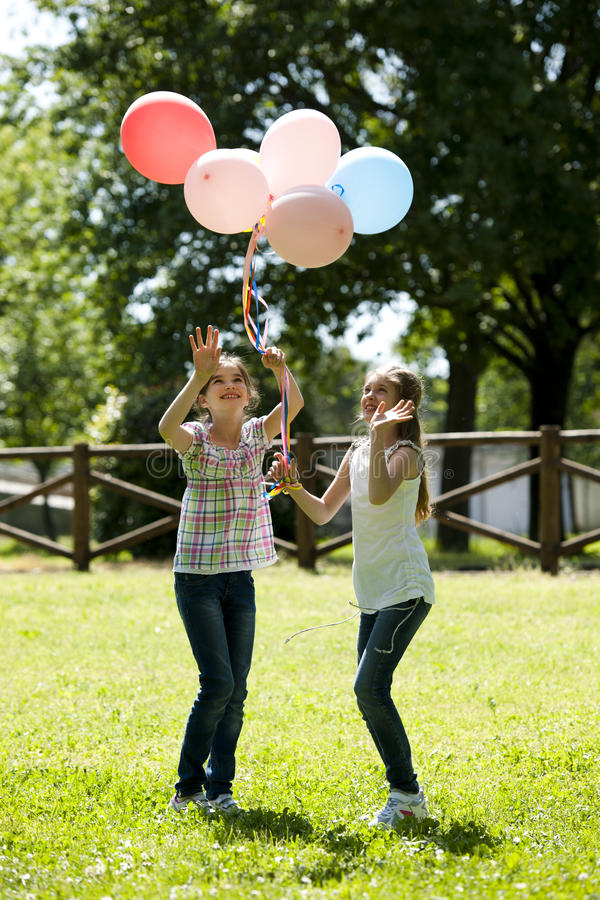 Download Two Little Girls Playing Outdoors Stock Photo - Image: 25926662