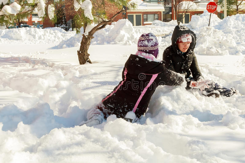 two little girls playing on the snow stock photography