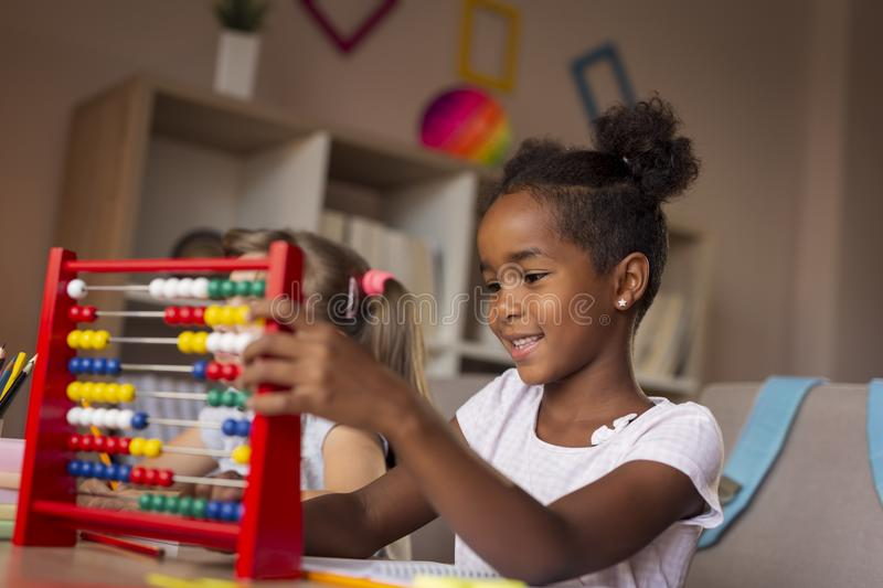 Girls using abacus royalty free stock photography