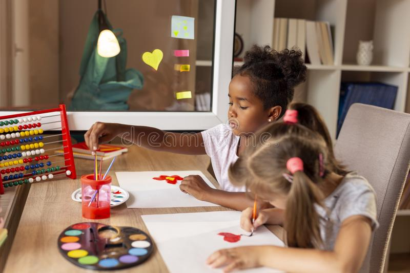 Girls painting with water colors royalty free stock image
