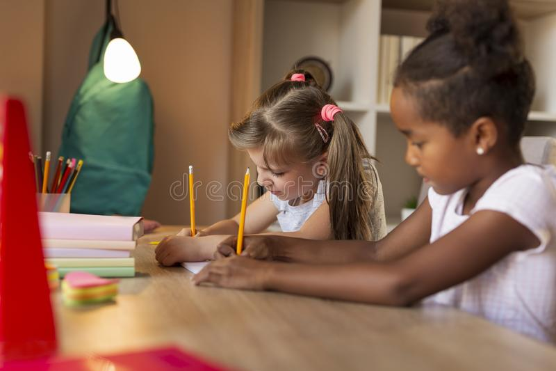 First grade girls doing math homework royalty free stock photo