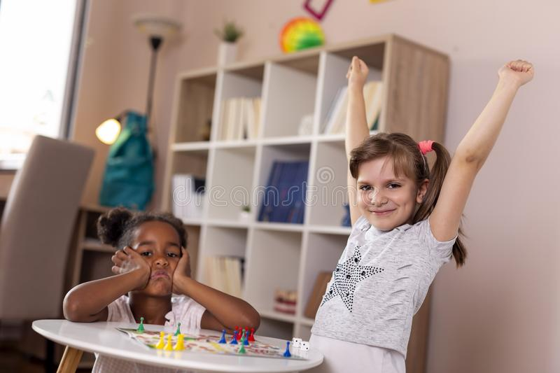 Playing ludo board game stock photo