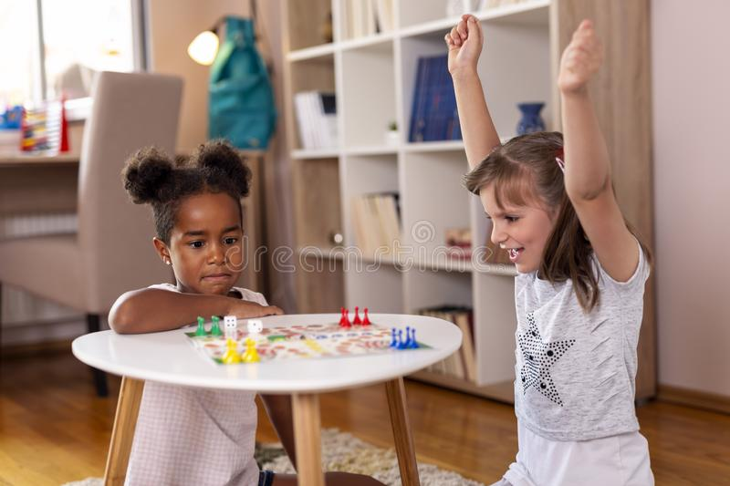 Playing ludo board game stock image
