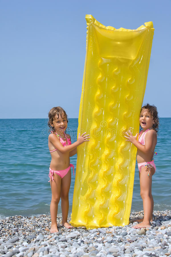 Two Little Girls Standing On Beach Royalty Free Stock Photography