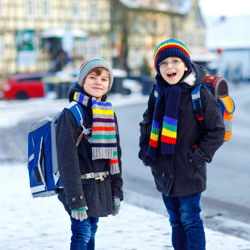 Two Little Kids Boys Of Elementary Class Walking To School