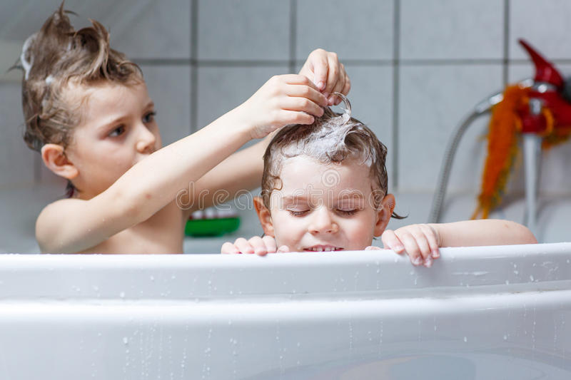 Download Two Little Kids Boys Playing Together In Bathtub Stock Image    Image: 80132107
