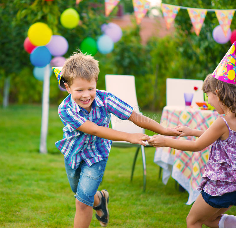 Two Little Kids Dancing Roundelay Stock Image