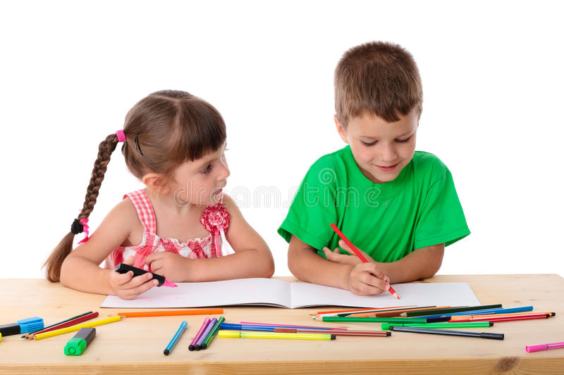 Two Little Kids Draw With Crayons Royalty Free Stock Photos