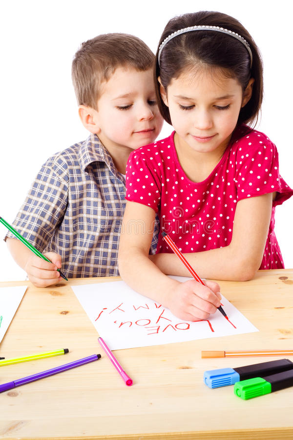 Two Little Kids Draw For Mum Royalty Free Stock Photos