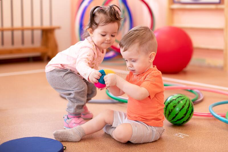 Two little kids in sports room royalty free stock images