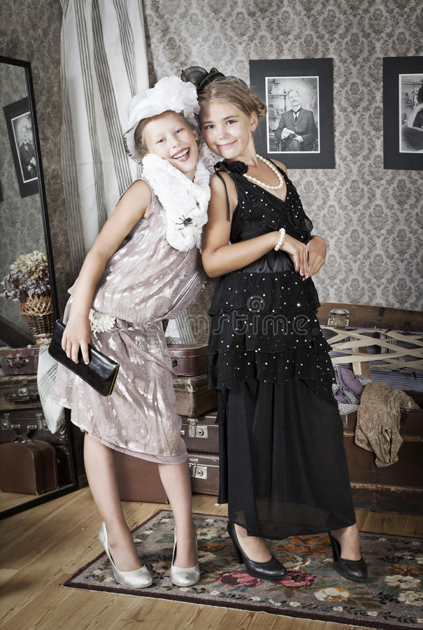 Two little Old-fashion girls stock photos