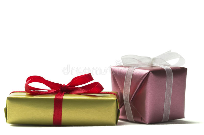 Two little present boxes. Two little present box with ribbon bow isolated over white background stock photos