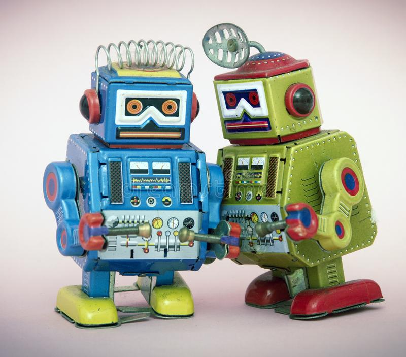 Two little robots share some gossip stock photos