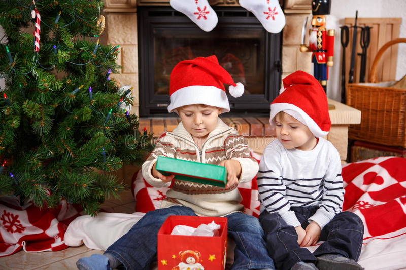 Two little sibling boys being happy about christmas present stock photography