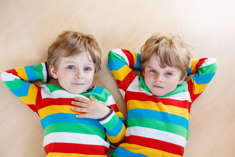 Download Two Little Sibling Kid Boys Having Fun Together Indoors Stock Photo