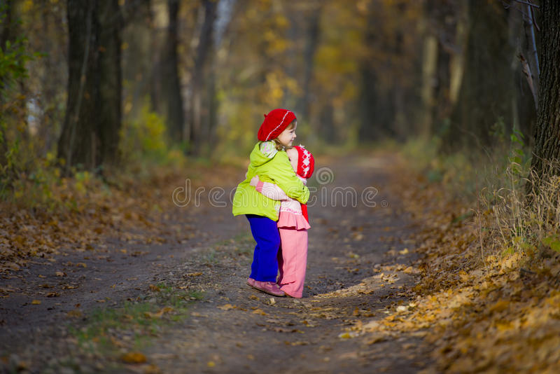 Download Two Little Sisters Embrace Each Other Stock Photo - Image: 27237430