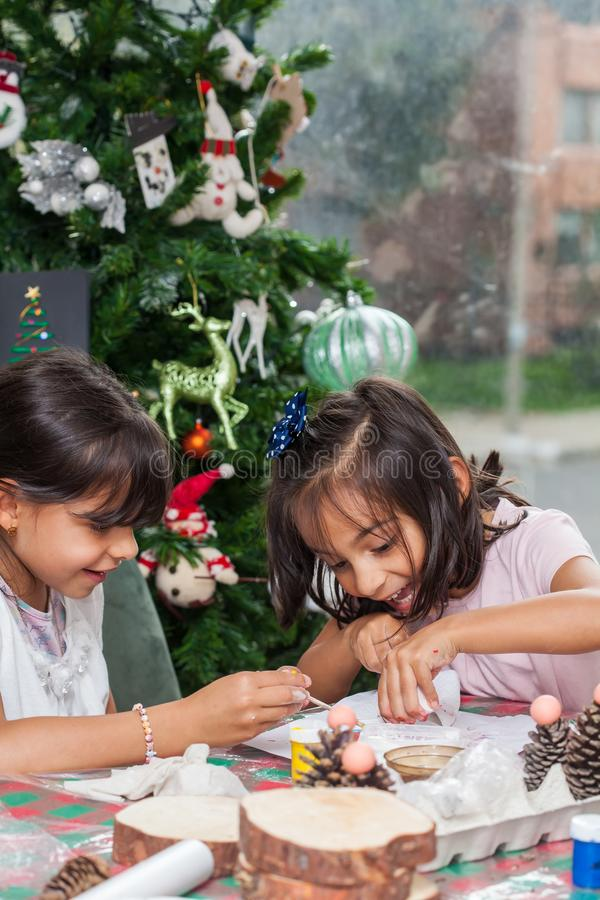 Free Two Little Sisters Having Fun While Making Christmas Nativity Crafts With At Home Royalty Free Stock Photos - 164397568