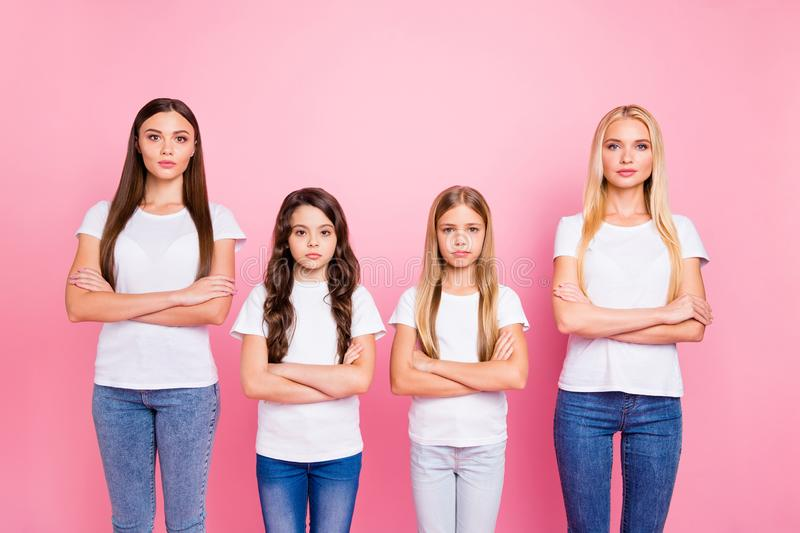 Two little and two students ladies crossing arms self-confident wear casual outfit isolated pink background stock photos