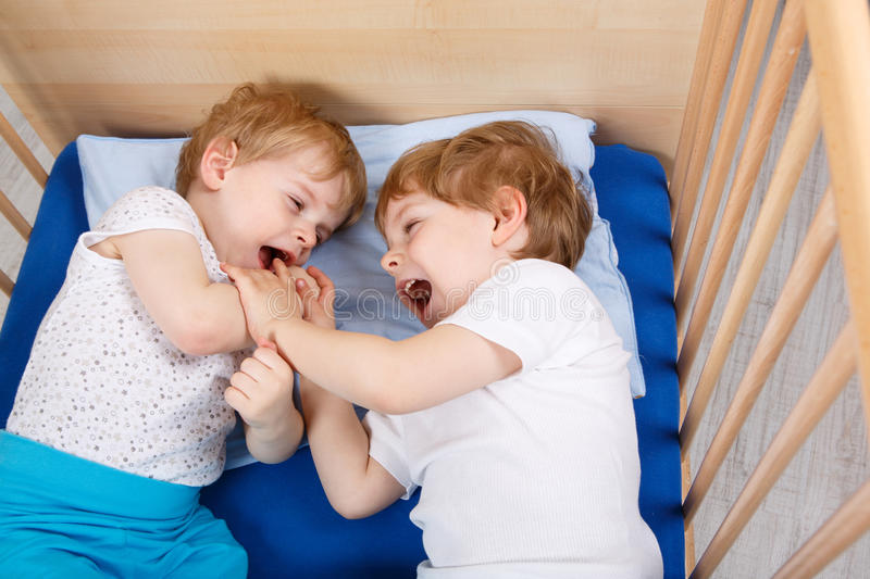 Download Two Little Toddler Boys Having Fun And Fighting Stock Photo