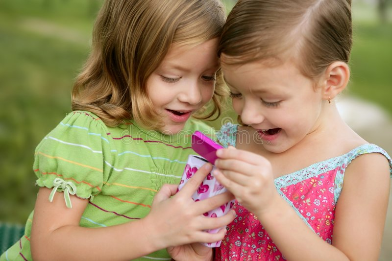 Download Two Little Twin Sisters Playing With Pink Box Stock Photo - Image of present, green: 8829332
