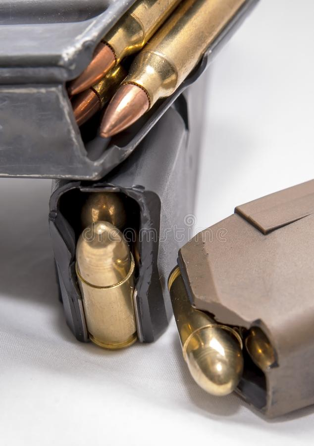 Two loaded 9mm pistol magazines with a loaded 223 caliber magazine royalty free stock photos