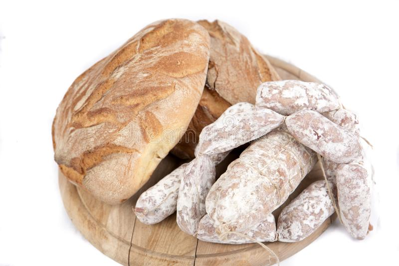 Loaves of bread and sausages stock image