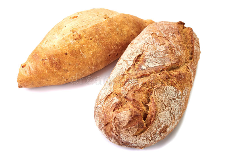 Two loaves of bread. On white background royalty free stock photography