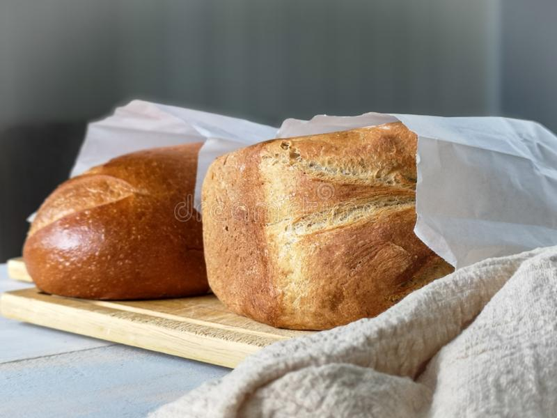 Two loaves of freshly baked bread stock images