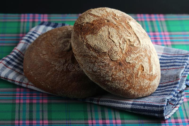 Two loaves of rye brown bread royalty free stock images