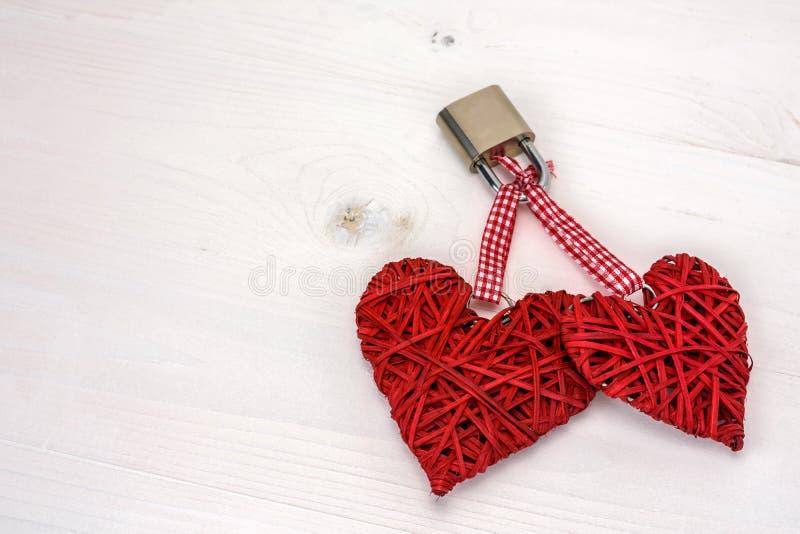 Two locked hearts stock image