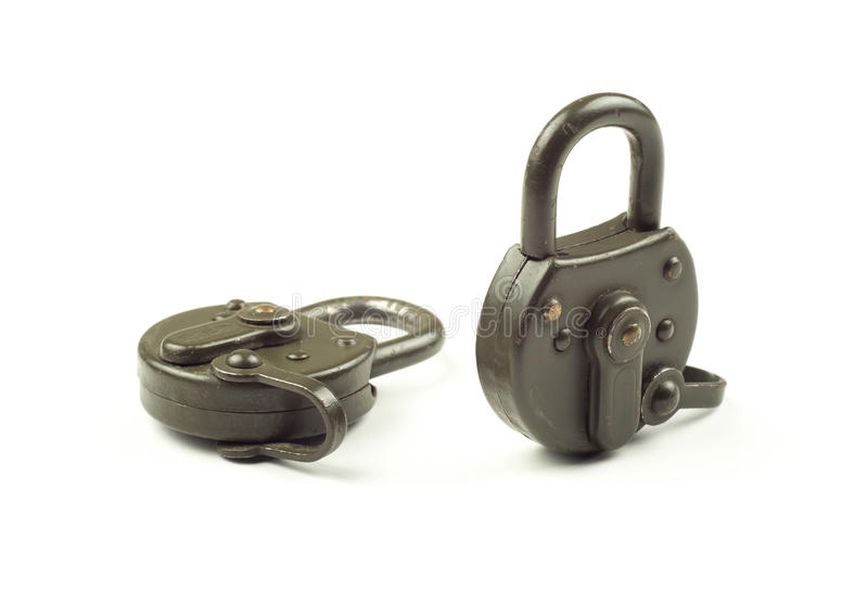 Two locked padlocks on a white background stock photos