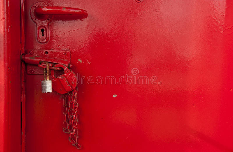 Two Locks. Secure a red door royalty free stock photos