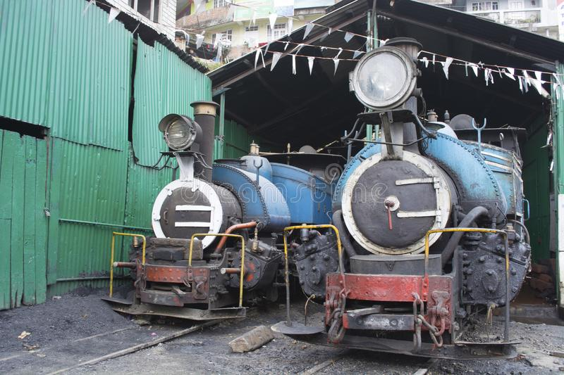Two locomotive steam engines in the car shed of kurseong of Darjeeling district of India. royalty free stock image