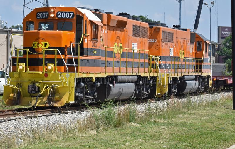 Two locomotives move freight on a small line. Two Carolina Piedmont locomotives haul freight near the end of the line in Greenville County SC USA on June 9 2018 royalty free stock photography