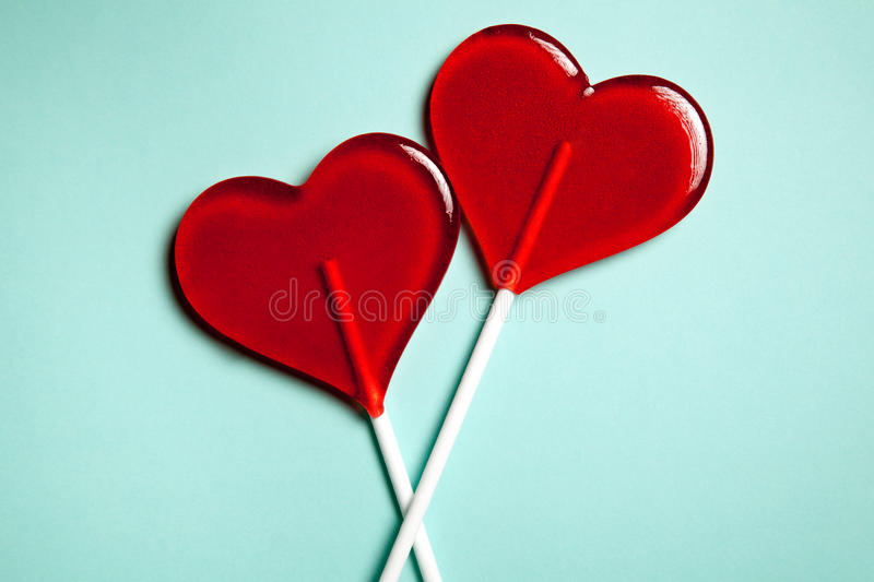 Two lollipops. Red hearts. Candy. Love concept. Valentine day. stock photography