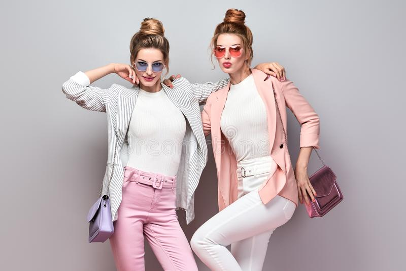 Two Fashion woman having fun, Trendy summer outfit royalty free stock photo