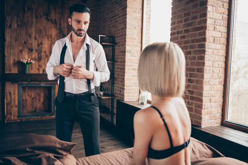 Two lovable person gorgeous attractive feminine lady waiting meeting rich wealthy businessman guy in loft brick. Industrial style interior room house hotel stock image