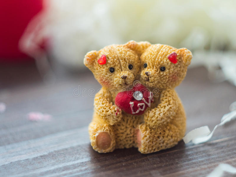 Two love bears on wooden background. Macro shot. Two love bears on wooden background. Free space for text royalty free stock photography