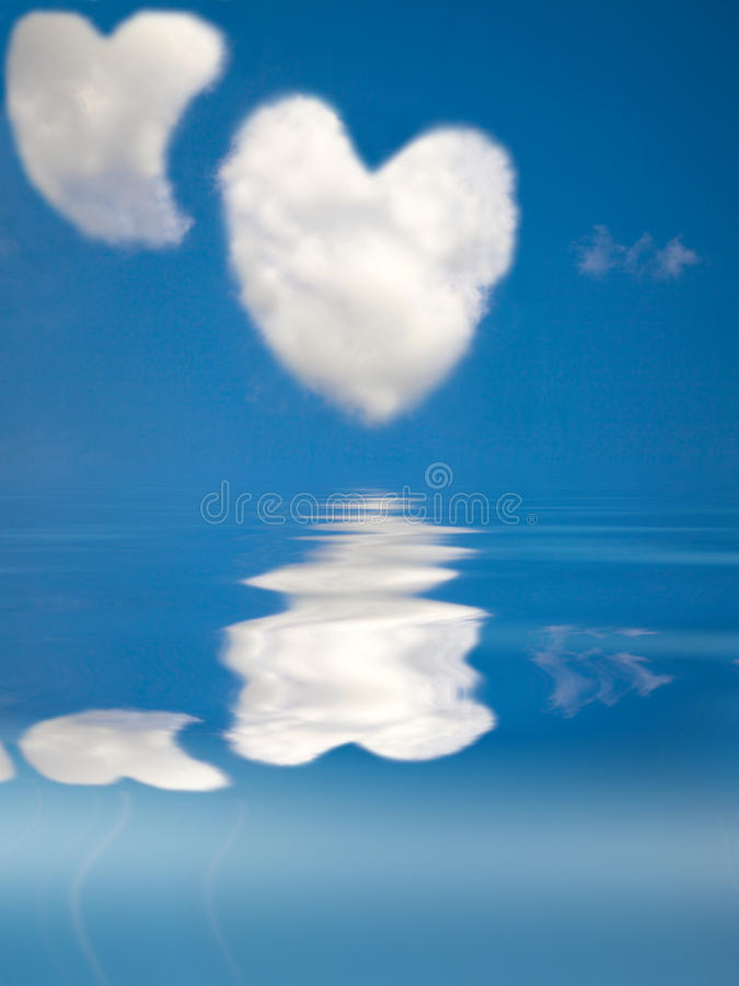 Two love heart cloud in the clear sky. And water royalty free stock photography