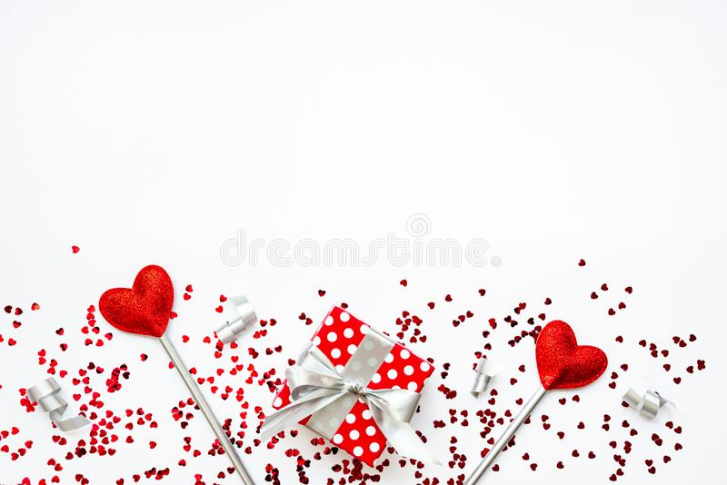 Two love magic wands and a gift. Valentine`s Day concept. Copy space.  stock photography